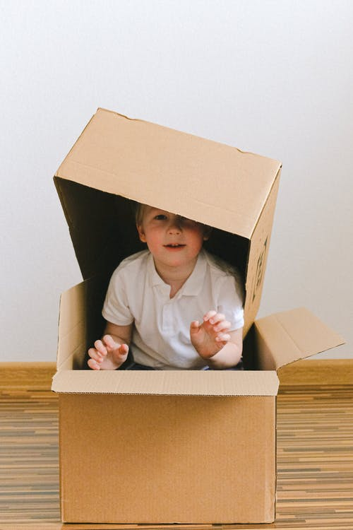 Boy Playing With Boxes