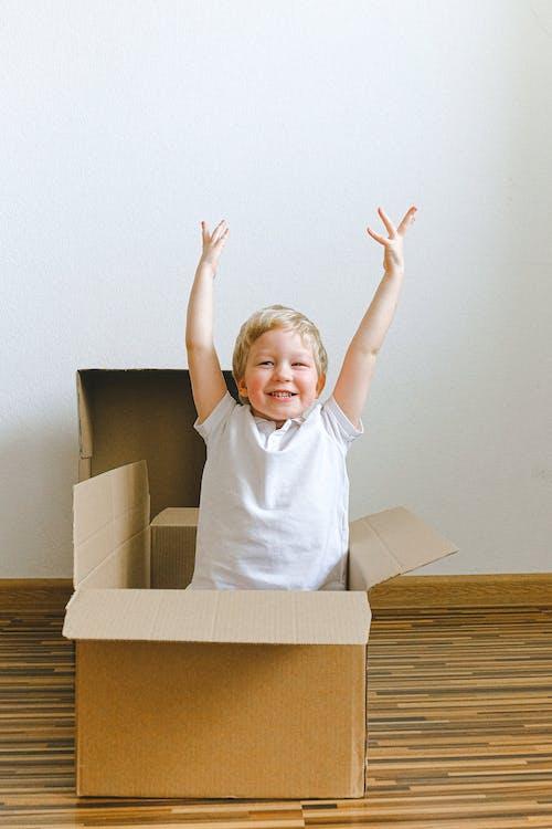 Boy In White Crew Neck T-shirt Inside A Box