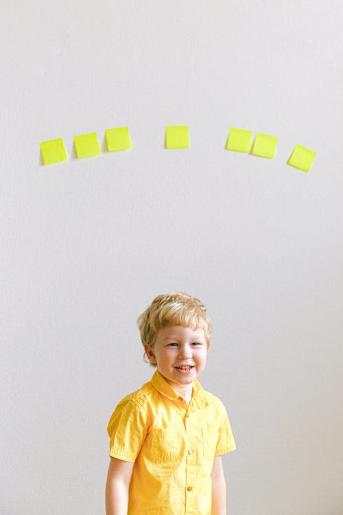 Boy In Yellow Polo Shirt