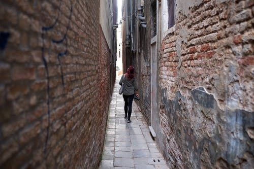 Free stock photo of bricks, city, corridor, girl