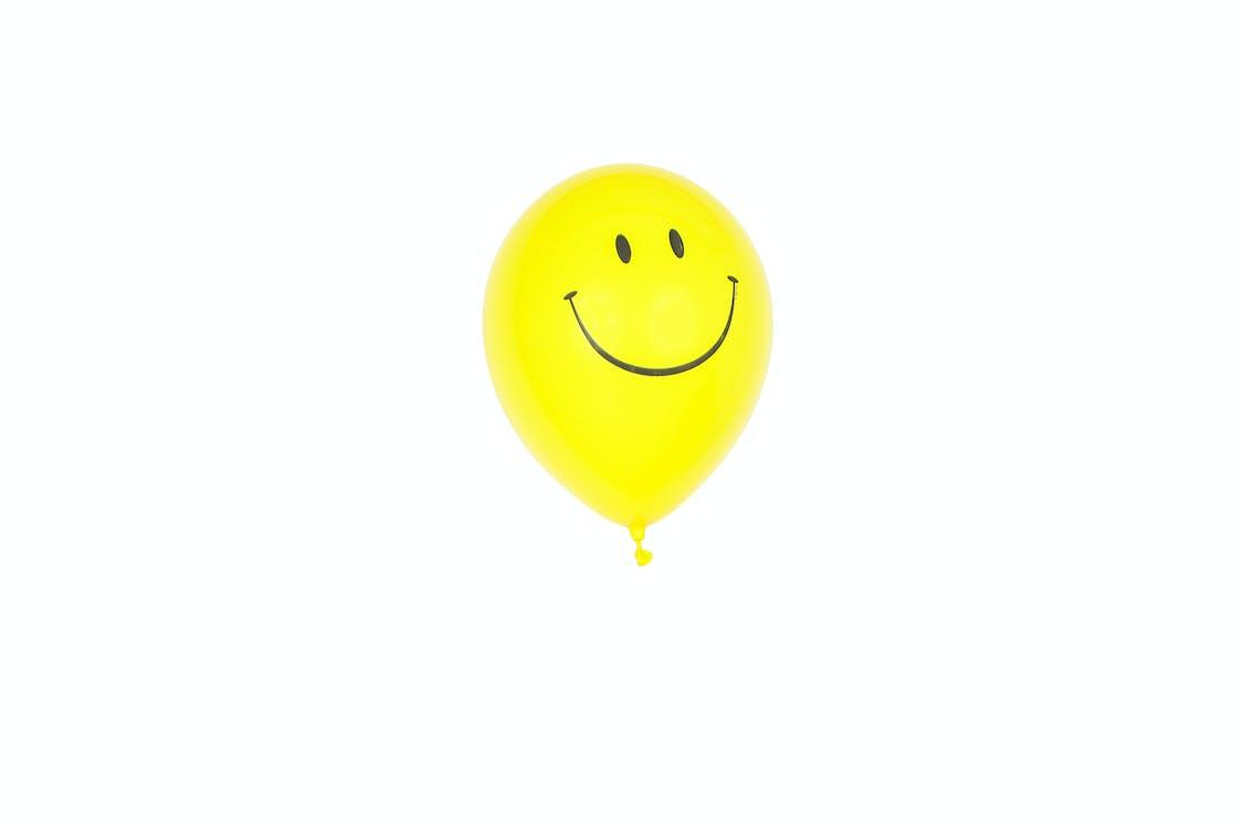 Yellow Smiley Balloon With White Background