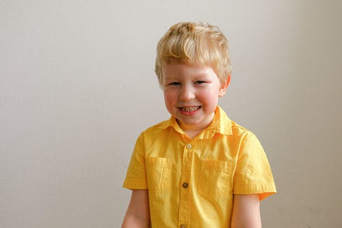 Boy In Yellow Button Up Shirt Smiling