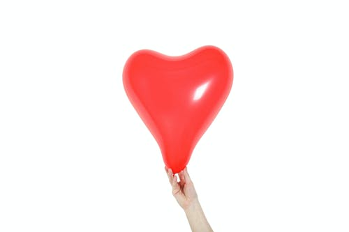 Red Heart Balloon On White Background