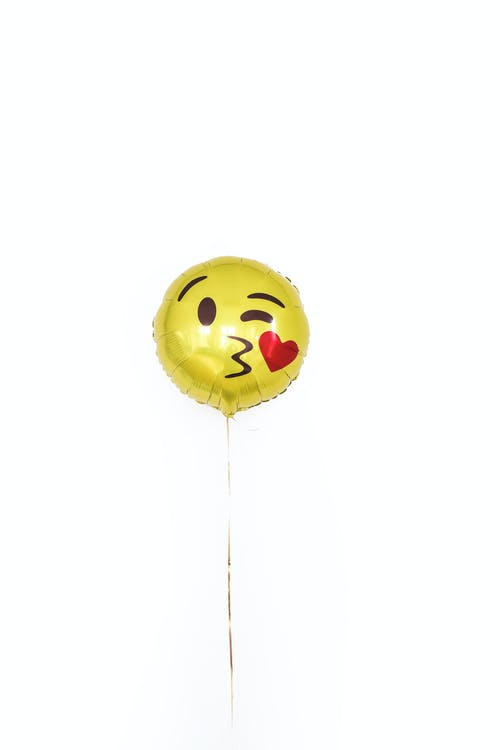Golden foil balloon with smiley kissing face and heart