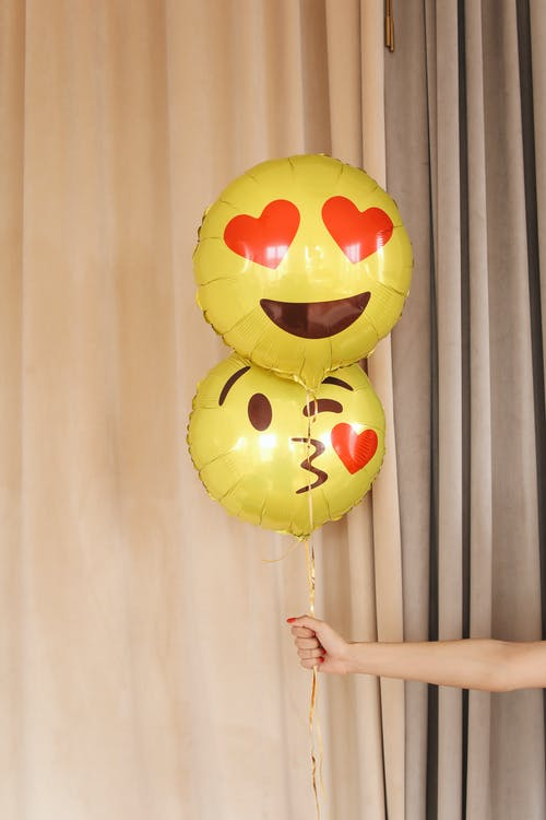 Yellow and Black Smiley Balloons