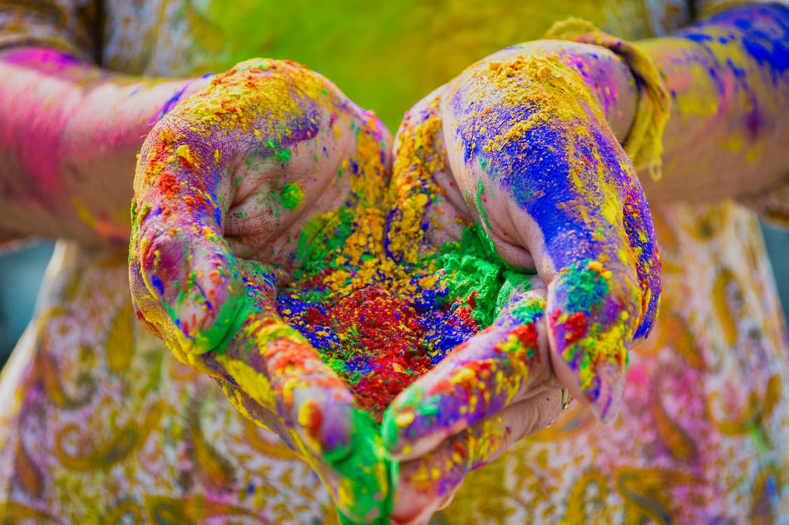 Person's Hand Full Of Colored Powder