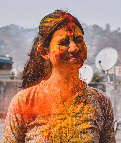 Woman Covered With Colored Powder
