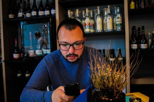 Free stock photo of man, person, bar, bottles