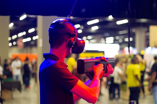 Man in VR headset in modern club