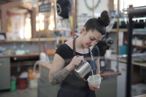 Woman In Black Crew Neck T-shirt Holding A Mug