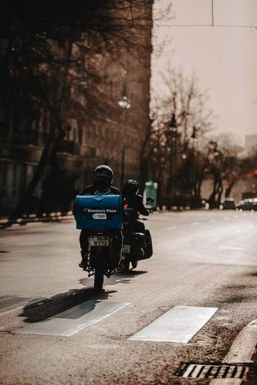 Person Riding A Motorcycle To Deliver Food
