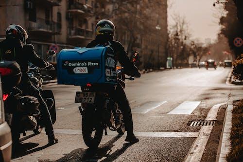 Man in Blue Helmet Riding Motorcycle on Road