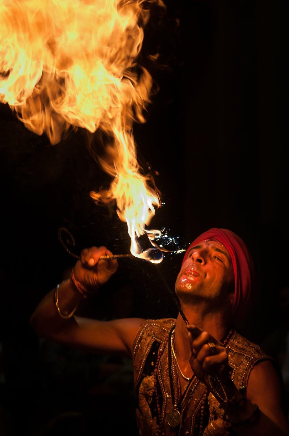 A man doing fire breath. | Photo: Pexels