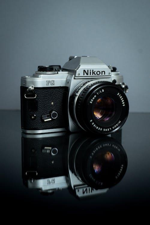 Black And Silver Nikon Dslr Camera