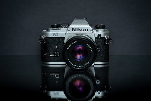 Black and Silver Nikon FG Camera