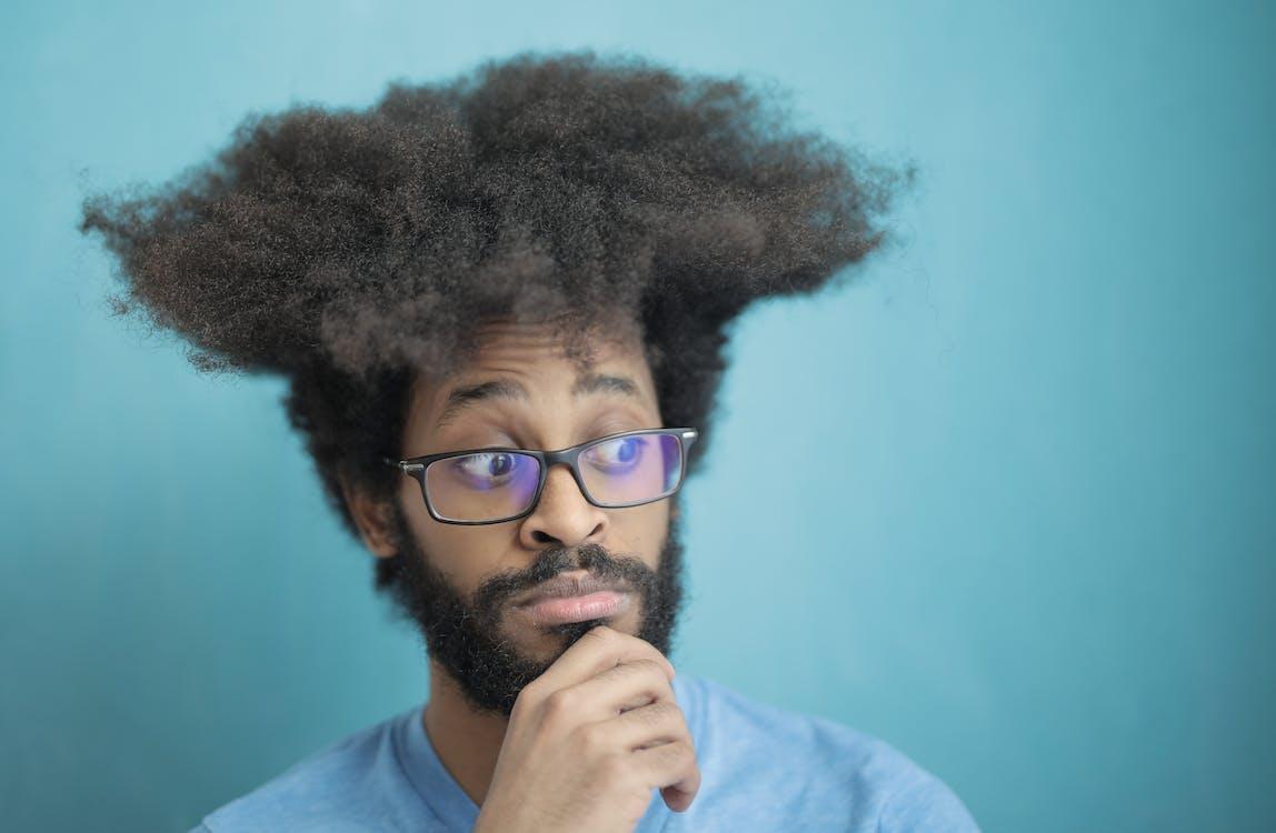 Man in Blue Shirt Wearing Black Framed Eyeglasses