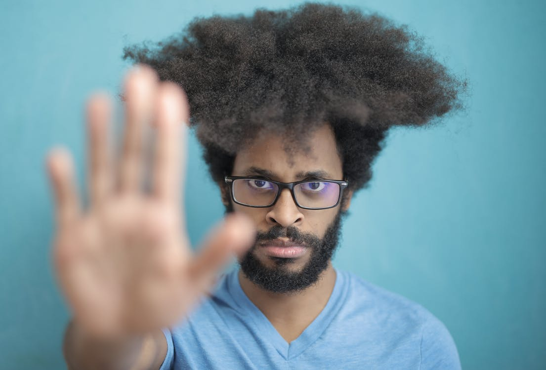 Man in Blue Crew Neck Shirt Wearing Black Framed Eyeglasses
