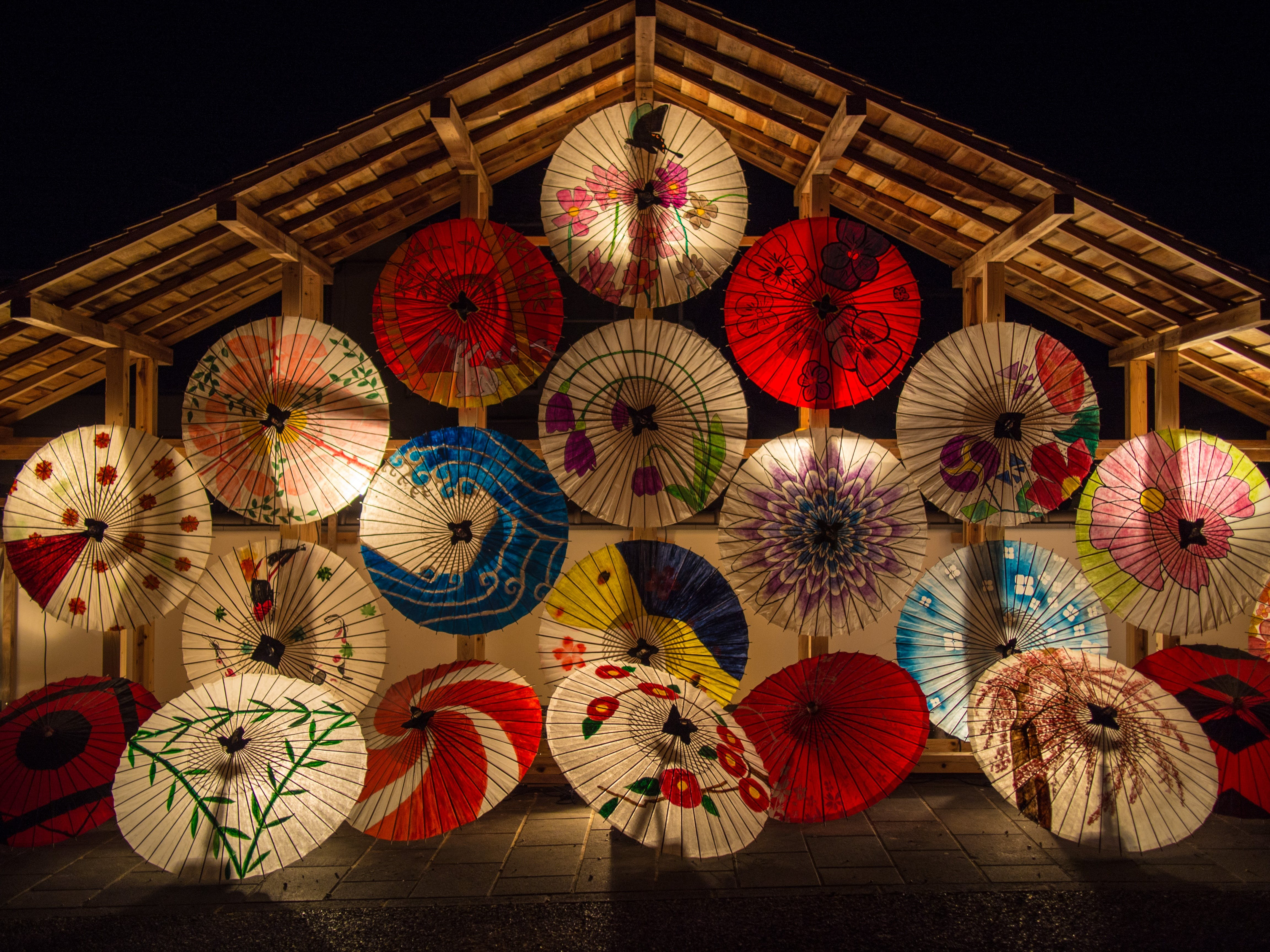 Red and White Umbrella during Night Time