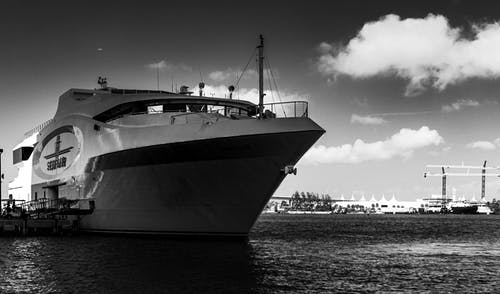 Free stock photo of black and white, blue water, boat