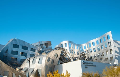 Contemporary quaint building of Lou Ruvo Center exterior with creative bendy walls on sunny day