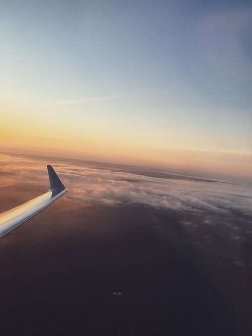 Free stock photo of above clouds, aircraft wings, airplane, airplane window