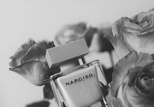Foto stok gratis aroma, bergaya, berkembang, botol parfum