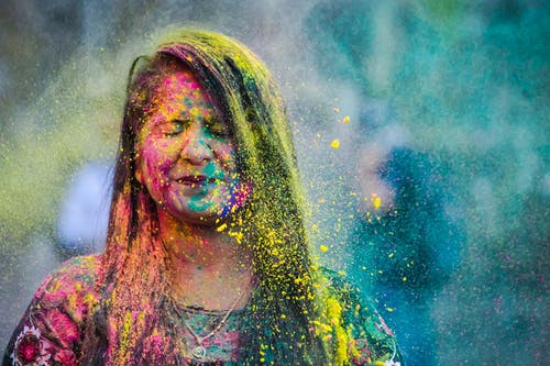 Woman Covered In Colorful Powder