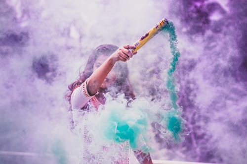 Woman Holding Colored Smoke Bomb