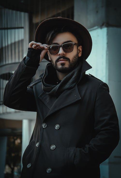 Man Wearing A Coat