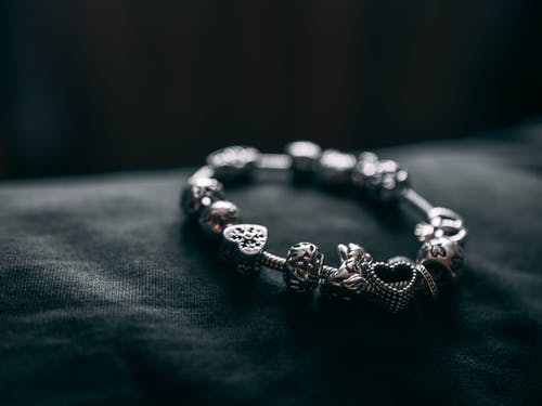 Silver Bracelet With Charms On Black Textile