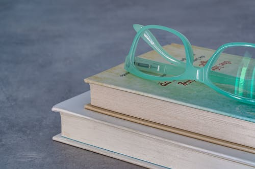 Eyeglasses On Top Of A Book