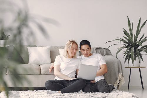 Man And Woman In White Crew Neck T-shirt Sitting On A Rug