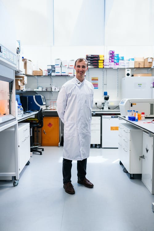 Scientist Standing in Laboratory