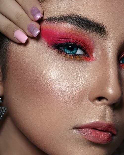 Close-up Photo of Woman with Pink Eyeshadow