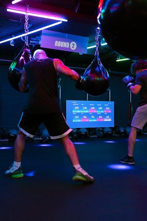 Men Boxing in Gym