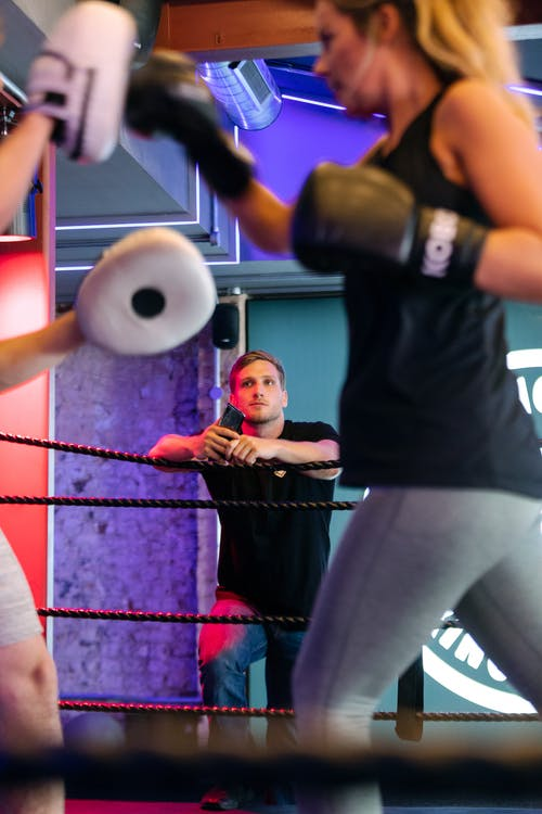 Woman Training in Boxing Ring
