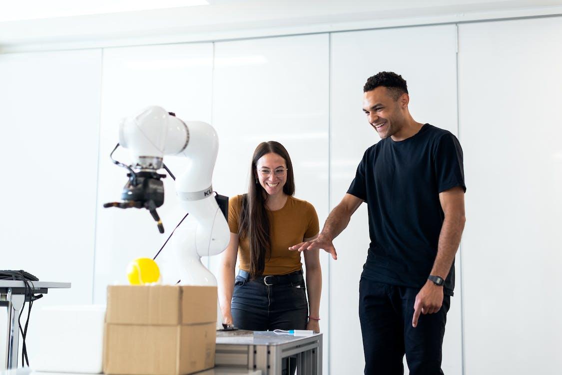 Engineers Developing Robotic Arm
