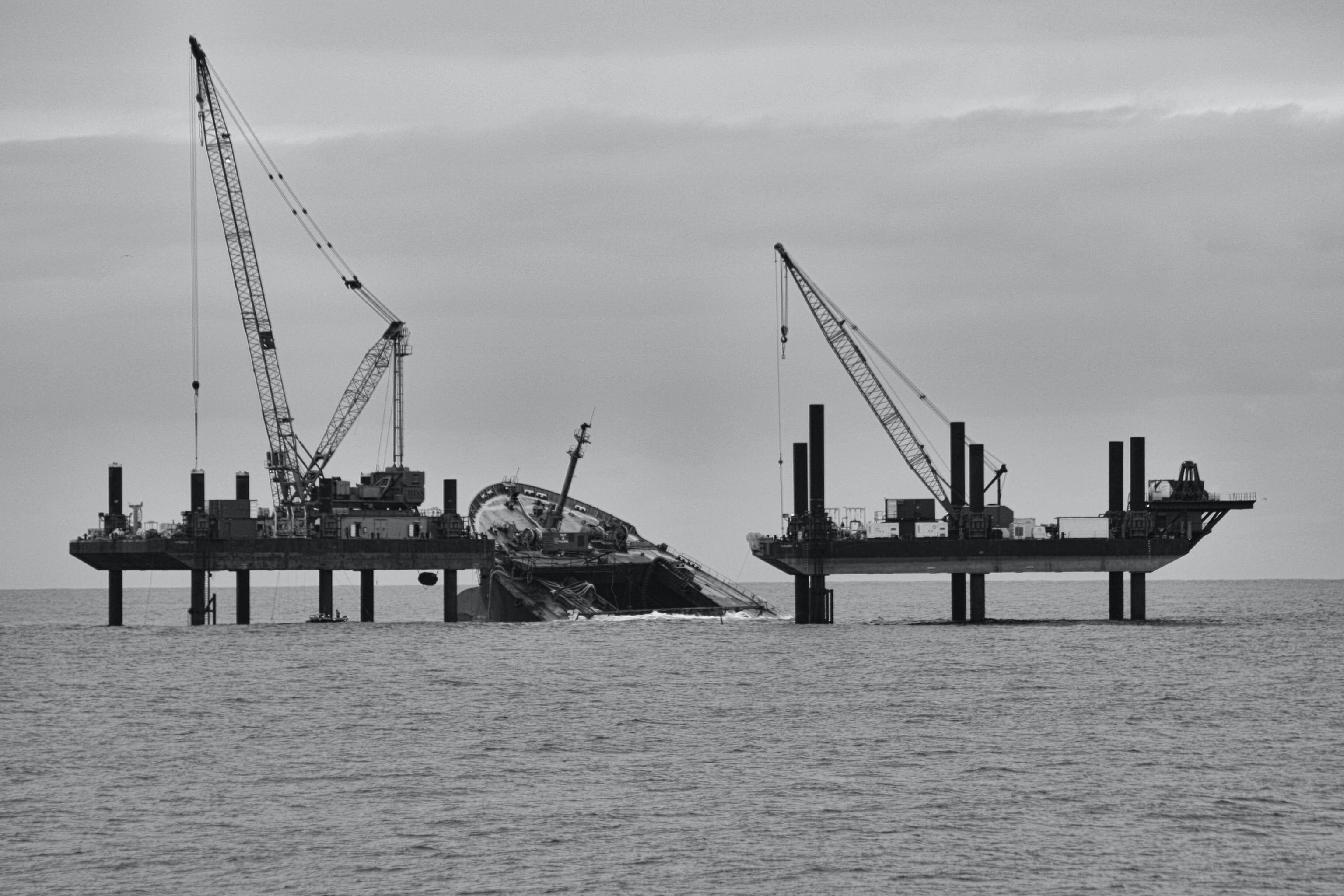 Free stock photo of black and white, container ship, cranes, half