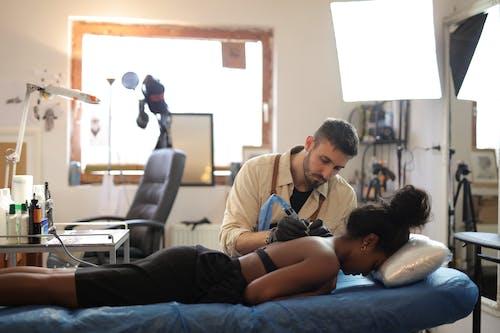 Woman Getting Tattoo