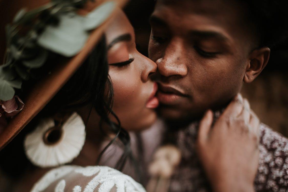 Close-Up Photo Of Man Kissing Woman