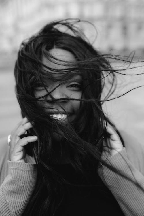 Monochrome Photo of Woman Smiling