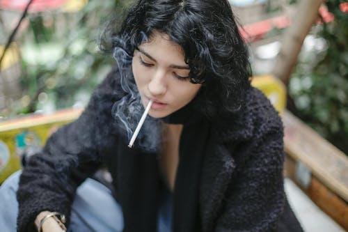 Photo Of Woman Smoking Cigarette