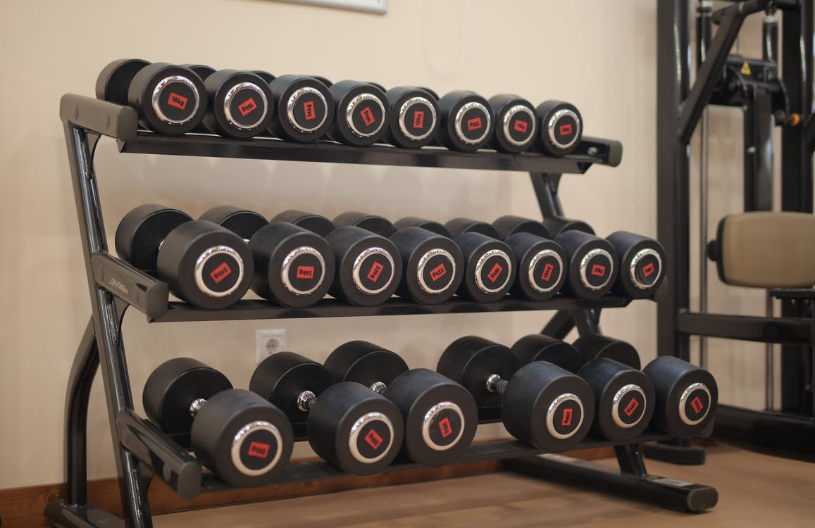 Black and Red Dumbbells on Brown Wooden Floor