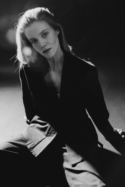 Photo of Woman Sitting On Floor