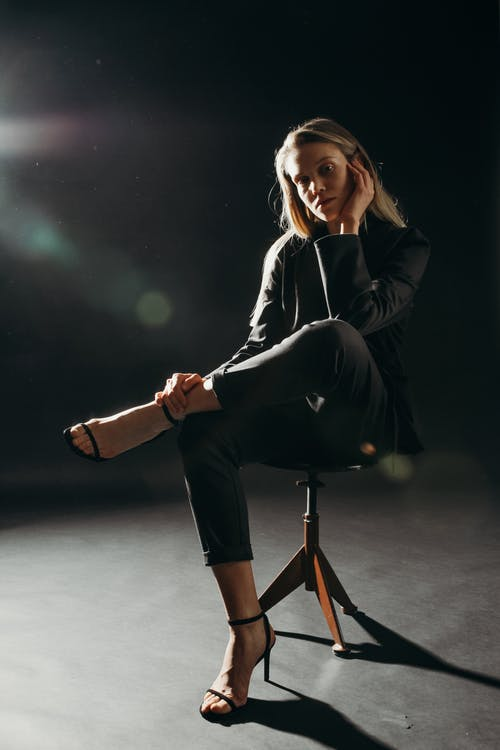 Photo Of Woman Sitting On Stool