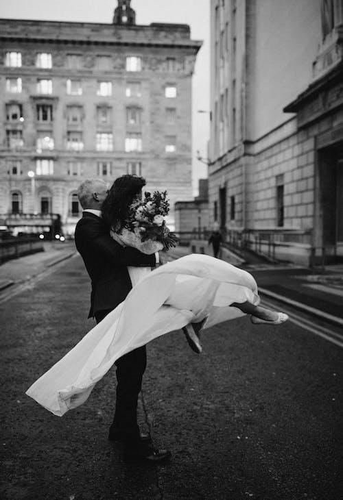 Monochrome Photo Of Man Carrying Woman