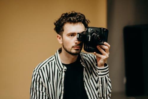Photo Of Man Holding DSLR Camera