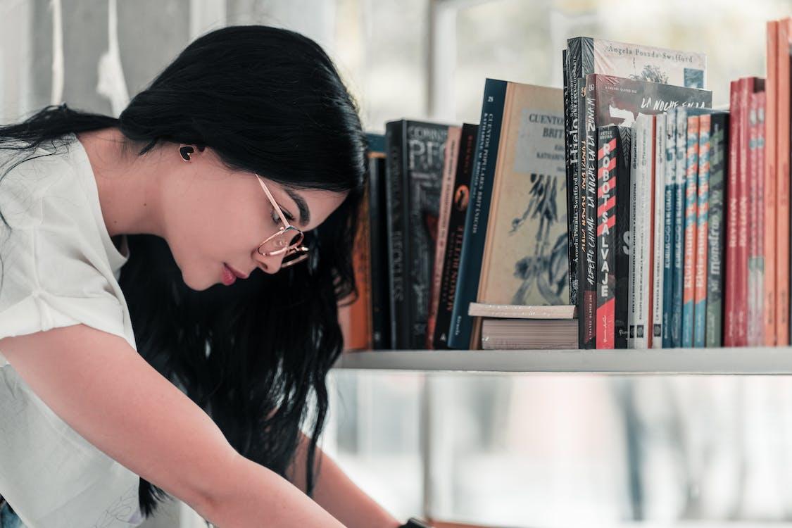 Photo Of Woman Near Books