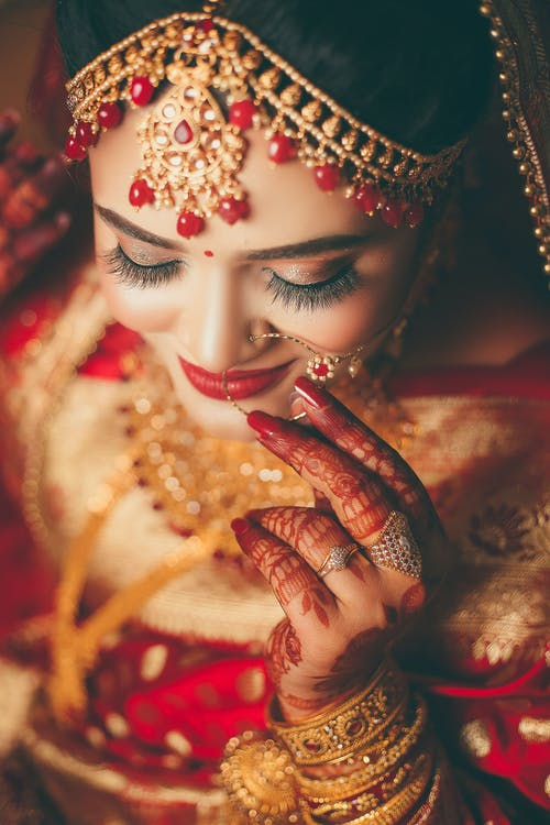 Woman In Red And Gold Traditional Wear