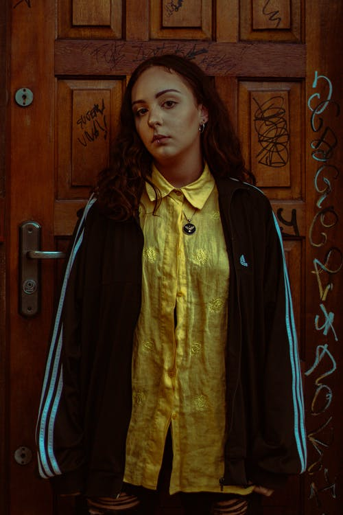 Woman Wearing Yellow Top And Black Jacket